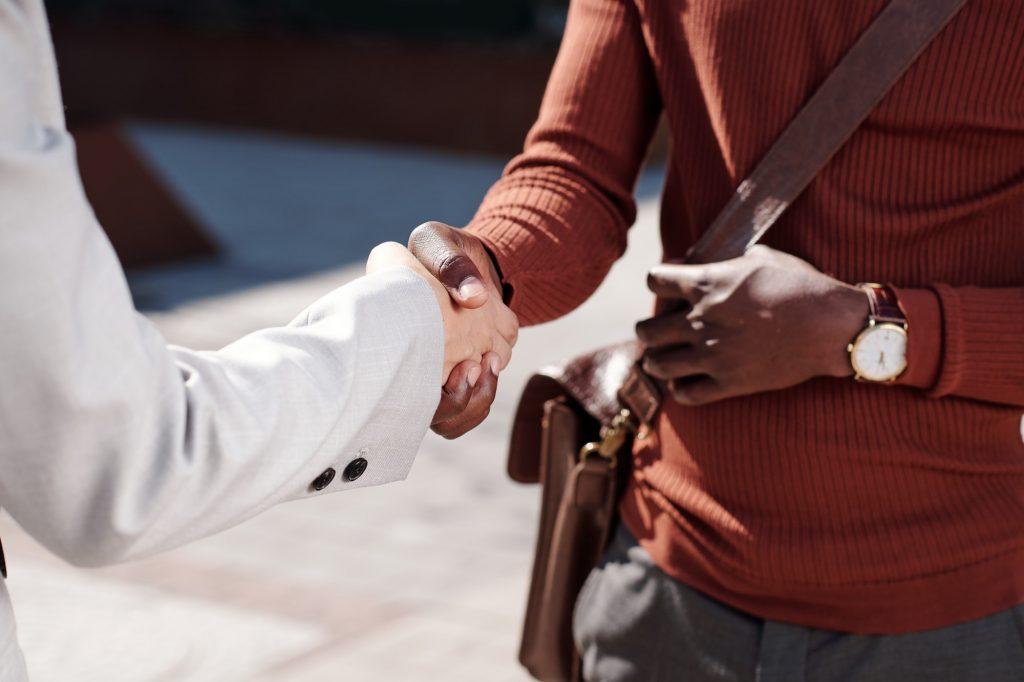 Handshake of two intercultural business partners